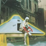 George Clinton dressed as the Star Child climbs out of the Mothership UFO