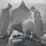 Members of the Kindred of the Kibbo Kift around the campfire