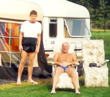 father and son wearing trunks